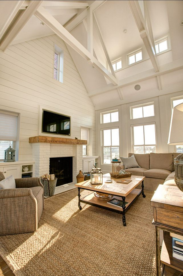 comfortable-casual-neutral-family-room-centers-on-the-seagrass-rug-and-high-vaulted-and-beamed-ceiling