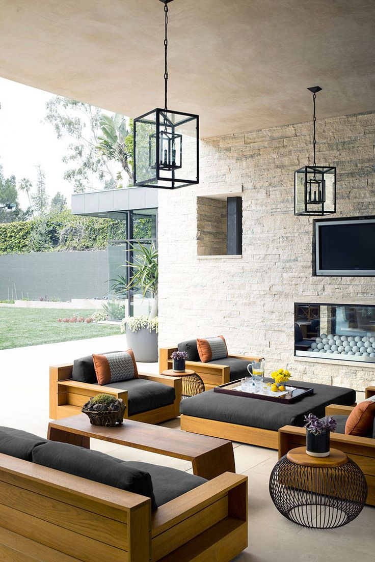 the-patio-complete-with-a-fireplace-and-james-perse-teak-furniture