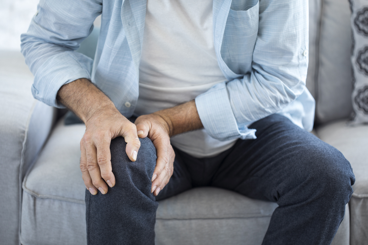 Old man suffering from knee pain